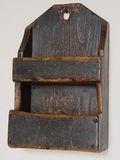 A double-tiered wallbox retaining the original gray painted and varnish finish. Dimensions: H W 10 D Date / Circa: Late century Maker / Origin: New England Medium: Constructed of pine with rose head nails. Primitive Furniture, Primitive Antiques, Country Furniture, Primitive Decor, Small Woodworking Projects, Wood Projects, New England Furniture, Old Wooden Boxes, Der Bus