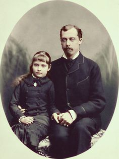 Alexandra as a child with her uncle and godfather Prince Leopold, 1879.  Leopold gave Alexandra a gold bracelet which she wore the rest of her life.  He died from complications from hemophilia, a disease that would have tragic consequences in Alexandra's own life.