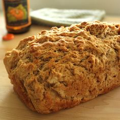 1 1/2 cups bread flour 1 1/2 cups whole-wheat flour 4 1/2 tsp baking powder 1 1/2 tsp salt 1/3 c brown sugar, loose 12 ounces beer 4 tbsp butter, melted (1/2 stick) Oven Temperature: 350 F 1. In the bowl of a stand mixer, combine the flours, baking powder, salt, and brown sugar. Mix on low speed. Add the beer and stir (lowest speed) until just incorporated. 2. Line a 9 x 5 inch bread pan with parchment paper. Pour the batter into the pan and cover with the melted butter. Bake for 50-60 min