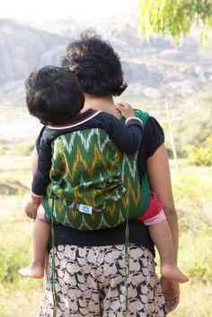 Frangipani on Green - Cotton Ikat Soul Meh Dai   #soulslings #soulmehdai #babywearing #toddlerworthy #cottonsoulmehdai #handwovenfabric #ikat