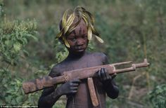 Sharp shooter: A young boy plays with a wooden gun. Although the tribes' rustic…