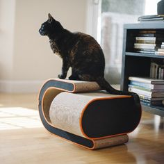 Arty Cat Scratcher | Meet Arty, P.L.A.Y.'s new versatile two-in-one cat scratcher. Designed with the fiercest scratchers in mind, this stylish cat retreat features multiple surfaces and angles to handle every cat's needs. Its bold curved design separates into two pieces and can be used together or apart to provide more than one scratching outlet in your home. Whether your cat desires to scratch, lounge or play this innovative design has everything covered! Shop at SkyMall.com!