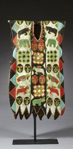 Africa | Vest tunic from the Yoruba people of Nigeria | Textile heavily embroidered with glass beads and cowrie shells