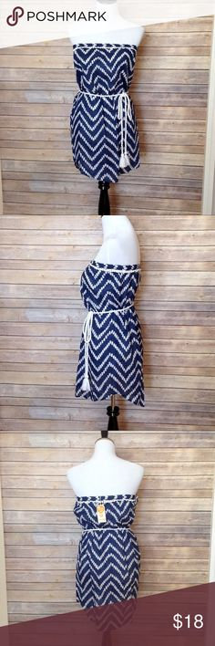 """Mud Pie strapless coverup with tasseled rope belt This swimsuit cover is a dark blue with a zig zag pattern. Features a flat pom pom trim and tasseled braided rope belt. Pullover design with elastic band at bustling. 100% cotton. My mannequin measures 34/28/36 APPROX FLAT MEASUREMENTS  27"""" ↕️ 13"""" ↔️ pit to pit SBB1 #swimsuitcover #strapless #tasselbelt #mudpie Mud Pie Swim Coverups"""