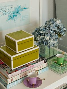 Green lacquer boxes, books, and hydrangeas | Ana Antunes