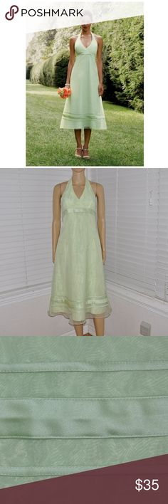 Organza Tea-Length Dress w/ Satin Ribbon Detailing Organza Tea-Length Dress w/ Satin Ribbon Detailing  David's Bridal  Style # F11876 size: 4 color: Honey Dew (green)  This organza halter dress is sophisticated and sexy. The tea length skirt is modest while still being young and fresh. This dress can be worn to a more formal event or a more casual event depending on the shoes and accessories.  @cjrose25  More formals in my Posh closet. David's Bridal Dresses Prom