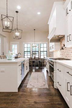 Love this simple clean white trendy kitchen... #kitchen #kitchendesign #trending #white #brick #backsplash #lighting #lanterns #quartz #interiordesign #interiordesignideas