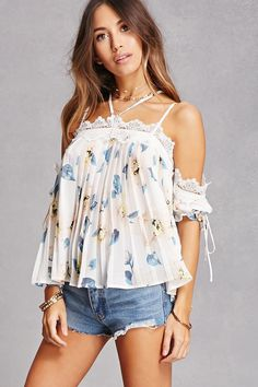 A semi-sheer, chiffon woven top featuring an allover floral print, pleated construction, an open-shoulder design, an adjustable halter neck with a clip-back closure, adjustable cami straps, cutout crochet trim, drawstring short sleeves, and a billowy silhouette. This is an independent brand and not a Forever 21 branded item.