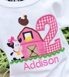 Appliqued Barn in Hot Pink With Age Appliqued in Hot Pink Gingham Check with embroidered farm chicken up top and Little cow beside with Bow up top. Finished with Lime Green Ric Rac below button sewn on door center. This tee will be perfect for a Farm themed birthday or for just everyday!! Colors can be changed to meet your party theme...just convo me with your requests. Available Onesie Sizes 0-3mo(0-7lbs) 3-6mo(8-16lbs) 6-12mo(17-24lbs) 12-18mo(25-29lbs) Tees 100% cotton (Girls Fitted) 1...