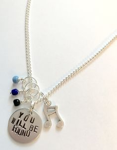 Inspired by the Broadway Musical, this necklaces features a charm of music notes with blue and black beads. A 3/4 disc has the lyrics You Will Be Found stamped on by hand. Comes on an 18 chain. Due to monitor settings, colors may vary from what you see on your screen. Since each item is stamped by hand, the exact spacing of the letters may be slightly different than what is pictured. No two pieces are exactly the same! All orders are shipped as soon as possible. Please understand that ...