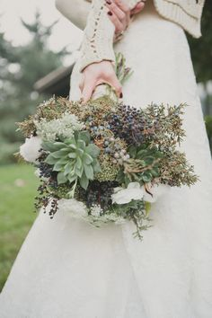 succulent, privett, queen anne's lace, blueberries, evergreen, and white ranunculas