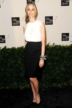 Lauren Santo Domingo- in a white blouse + black skirt- minimal and classic