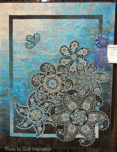 """A Pocket full of Paisleys, 57 x 71"""", by Lorilynn King (Longmont, CO).  2014 AQS, photo by Quilt Inspiration"""
