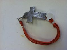 Hammered pewter cross and leather bracelet by mancinisouth on Etsy, $24.00