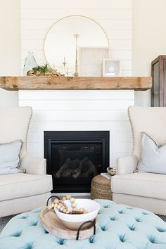 White shiplap fireplace with wood mantel