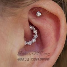 """Healed Daith Piercing with a white gold and diamond """"Tiffany"""" ring made of . - Healed Daith Piercing with a white gold and diamond """"Tiffany"""" ring made of … – Jewelry – - Faux Piercing Oreille, Innenohr Piercing, Spiderbite Piercings, Daith Piercing Jewelry, Bar Stud Earrings, Cartilage Earrings, Crystal Earrings, Crystal Jewelry, Piercings For Girls"""