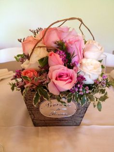 Tea party rose garden arrangement in wooden garden box with pink and white roses, wax flower, purple limonium, curly willow and Italian pittosporum.