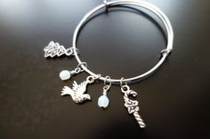 Christmas-themed Silver Charm Bangle by BeadingforChange on Etsy
