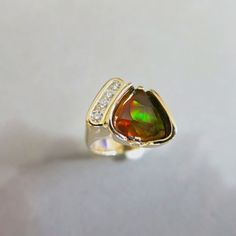 Fire agate and diamond ring by Glenn Dizon Designs.  Just finished and ready for that one lucky client.