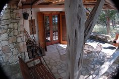inviting entrance to a beautiful Cob House. Check out the rock patio-just like mine.