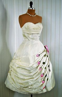 Wedding Dress: 1950's, heavily-draped taffeta, pleated shelf-bust bodice, 3-D rose applique detailing, ruched skirt, back bow.