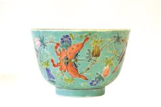 A Chinese Enameled Turquoise Porcelain Bowl, 19th century, Qing dynasty. The deeply potted bowl enameled with butterflies amidst branches bearing prunus flowers and Buddha's hand citrons all on a turquoise ground, iron red Jiaqing mark to base. Approx. 3 1/4 by 5 in. diam