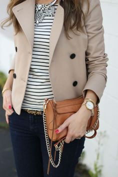 Waist length trench coat, statement necklace, striped t-shirt, skinny leopard belt, dark skinny denim, and brown handbag