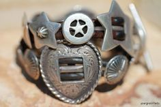 A pair of coveted vintage Southwestern bracelets by Arnold Goldstein.