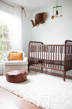 Well I'm already halfway to having this nursery. Same crib, rug and similar wall color and curtains.