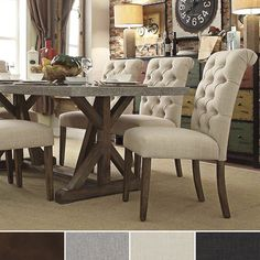 Immerse yourself in the regal manufacturing of this scrolled back, armless dining chair. Deep button tufts add a hint of sophistication and lends in this chair's superior comfort. Fully upholstered, t...