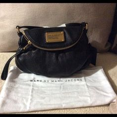 Marc Jacobs Sling bag Cow Leather Magnetic Snap Closure 43'' adjustable strap Brass hardware 1 zip exterior pocket 2 open interior pockets 1 zip interior pocket Jumbled logo lining 11.00x3.50x8.75 MSRP $298 Marc by Marc Jacobs Bags Crossbody Bags