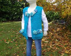 Crochet Renaissance -Nakita Knitted Vest. 2-3, 4-5, 6-7 yrs. #crochet #crocheting #crochetlove #crochetaddict #knit #knitting #knittersofinstagram #handcrafted #crochetclothing #crochetrenaissance #alleyjdesigns #alleyj #crochetpattern #timeless #crochetforkids #knitforkids #boho #bohostyle #crochetkids #cutecrochet #kidscrochet #knittingaddict #top #vest #winter #spring #yarn #autumn