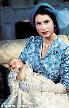 Princess Elizabeth (future Queen) cradling Princess Anne in 1950