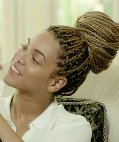 Box braids put up in a bun