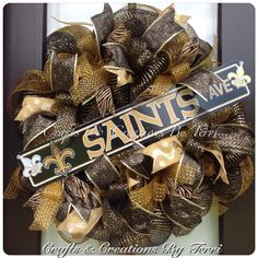 New Orleans Saints wreath.  More wreaths can be found on my Facebook page: www.facebook.com/CraftsandCreationsByTerri or go to my Etsy page https://www.etsy.com/shop/CreatedByTerri