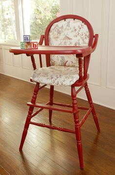 Wooden high chair. Love the red! It would be cute in any color. :)