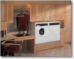 Like the raised washer and dryer. Roll under sink and rolling basket are nice laundry room elements, too