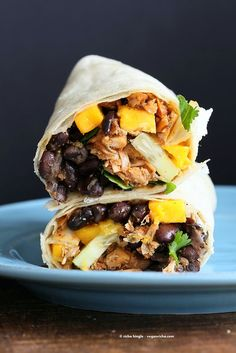 Jamaican Jerk Jackfruit Caribbean Black Bean Mango Wraps. These Burritos are packed with hot shredded jerk jackfruit, black beans, mango and cucumbers. Serve as wraps or make a sandwich or bowl. Vegan Soy-free Recipe. Can be gluten-free   VeganRicha.com