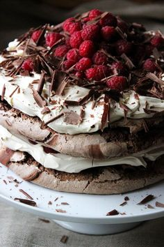 Chocolate Meringue Layer Cake  -- A crunchy, chewy, rich and decadent chocolate meringue layer cake. Layered chocolate meringue, sitting pretty inbetween layers of soft, vanilla bean whipped cream, topped with fresh raspberries and dark chocolate shavings.
