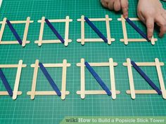 How to Build a Popsicle Stick Tower. Popsicle stick towers are a common engineering project to be assigned in school.Your assignment may have various criteria for height, weight, and number of popsicles, but this guide will give you a. Craft Stick Projects, Diy Wood Projects, Craft Stick Crafts, Popsicle Crafts, Vbs Crafts, School Projects, Projects For Kids, Crafts For Kids, Stick Art