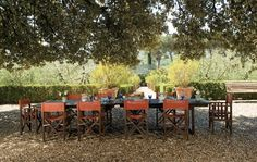 Lunch is often served on a gravel terrace in the shade of an oak tree. Sting and Trudie