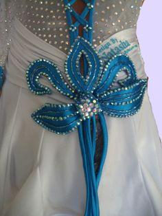 Blue flower detail on white latin dress