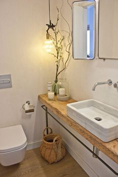 A Natural, Neutral & Sunny Duplex Penthouse in Barcelona The marble sink and wooden countertop give the guest bathroom a rustic feel. Wooden Bathroom Countertop, Counter Top Sink Bathroom, Wooden Countertops, Bathroom Sink Decor, Toilet Sink, Boho Bathroom, Bathroom Interior Design, Modern Bathroom, Small Bathroom