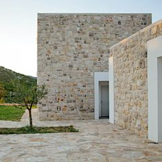 Stone from a local quarry was used for the cladding, paving and retaining walls of this cluster of buildings by DVA Arhitekta, built on a sprawling site in Bosnia and Herzegovina