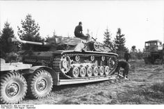Great picture of the heavy duty transport trailer used for vehicle recovery. This Stug 4 is possibly being delivered after repairs have been made.