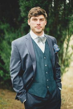 Handsome winter groom. by JoPhoto, The Bride Link, and LB Floral!  http://www.thebridelink.com/blog/2014/02/18/country-christmas-wedding-ideas/