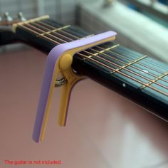 3.22$  Watch now - http://ai30n.worlditems.win/all/product.php?id=I1275 - Andoer Bicolor Single-handed Nylon Guitar Capo Tune Quick Change for Acoustic Classical Electric Guitar Ukulele and Bass Color Randomly Delivered