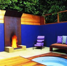 I'm not a huge fan of the blue wall, but the steel fireplace, and I would love to soak in that hot tub next to the fire. (Designed by Rob Steiner)