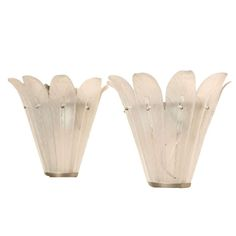 Pair of Art Deco Wall Sconces by Sabino   From a unique collection of antique and modern wall lights and sconces at http://www.1stdibs.com/furniture/lighting/sconces-wall-lights/