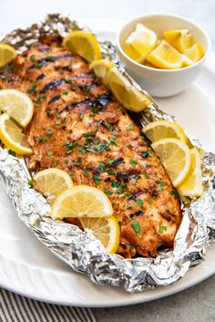 Grilling this Soy Brown Sugar Salmon in Foil makes for an easy weeknight dinner that is impressive enough to serve as weekend fare for guests. The salmon is first marinated in a simple marinade, the Salmon In Foil Recipes, Grilled Salmon Recipes, Grilled Fish, Salmon Grilled In Foil, How To Grill Salmon, Grilled Salmon Marinade, Bbq Salmon In Foil, Salmon Dinner, Tilapia Recipes